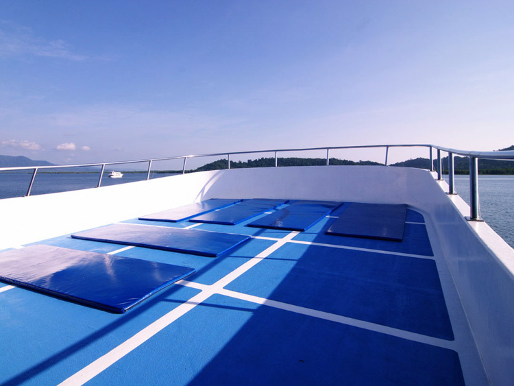 Relax between the dives on the Manta Queen 2 sundeck