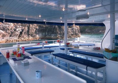 Spacious dining deck on the Manta Queen 3