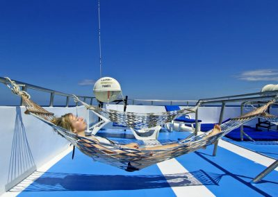 Relax between the dives on the Manta Queen 3 sundeck
